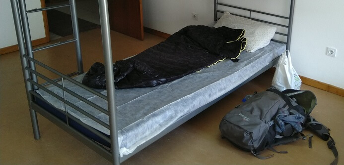 Aegismax sleeping bag on a hostel bed