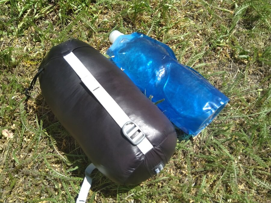 aegismax sleeping bag next to a water bottle